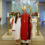 Bishop with female confirmandi longer angle
